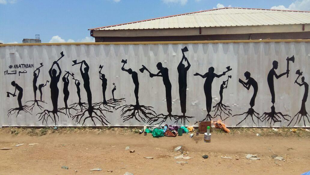"Artists from the peace group Ana Taban painted a wall mural in the capital, Juba, called ""Cutting Our Roots,"" to suggest the self-destructive nature of the country's communal civil war. (Ana Taban photo)"