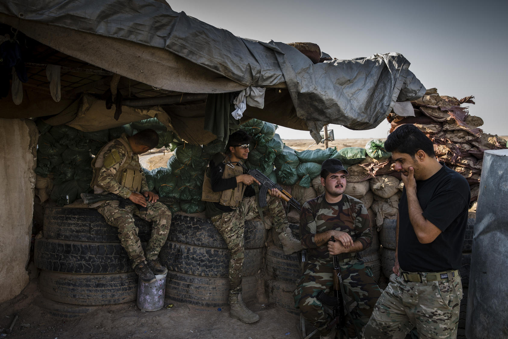 Kurdish peshmerga soldiers at a front-line position along the eastern edge of territory still held by Islamic State militants, near the city of Hawija, Iraq, Aug. 27, 2017.