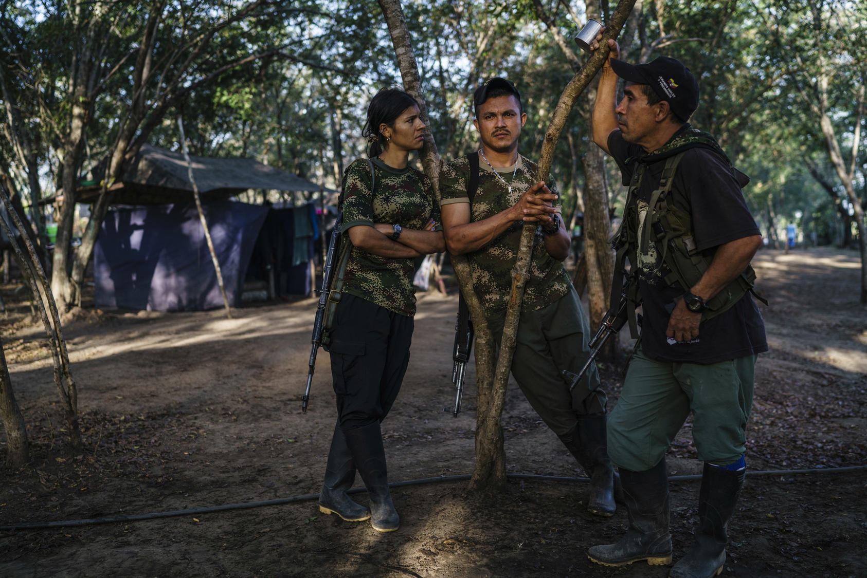 FARC members discuss their future in one of the zones set up to transition the former rebels back to civilian life, near La Paz, Colombia, Feb. 1, 2017. Photo Courtesy of The New York Times/Federico Rios Escobar