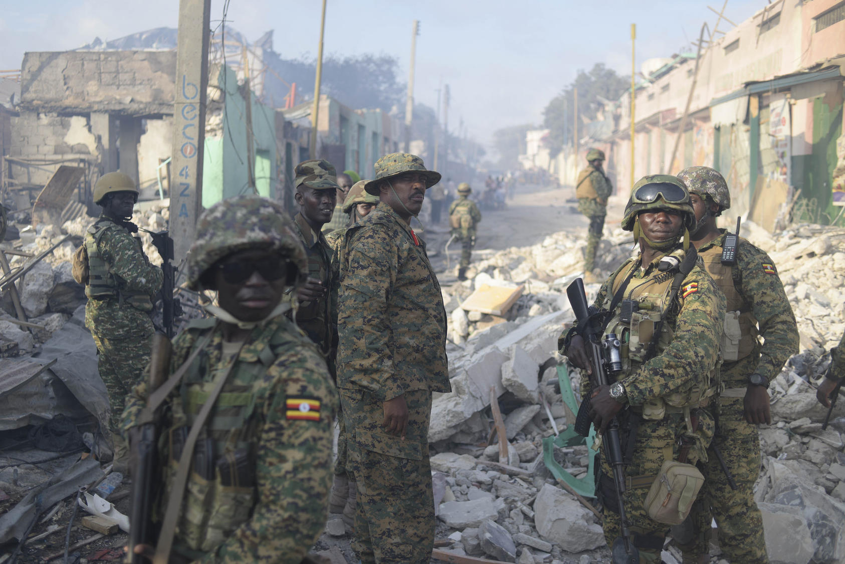 The African Union Mission in Somalia's Ugandan Contingent Commander, Brigadier General Kayanja Muhanga, visits the site of a VBIED attack conducted by the militant group al Shabaab in the Somali capital of Mogadishu on October 15, 2017. Photo Courtesy of Flickr/AMISOM Photo/Tobin Jones