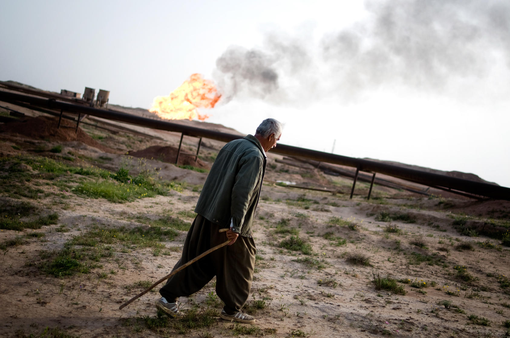 A Kurdish shepherd passes a flare from an oil well in Kirkuk, Iraq, March 12, 2010. Iraqi Kurds are selling oil and natural gas directly to Turkey, infuriating Washington and the central government in Baghdad, which fear that oil independence could lead Kurds to declare a broad independence and the fracturing of the nation. (Ayman Oghanna/The New York Times)