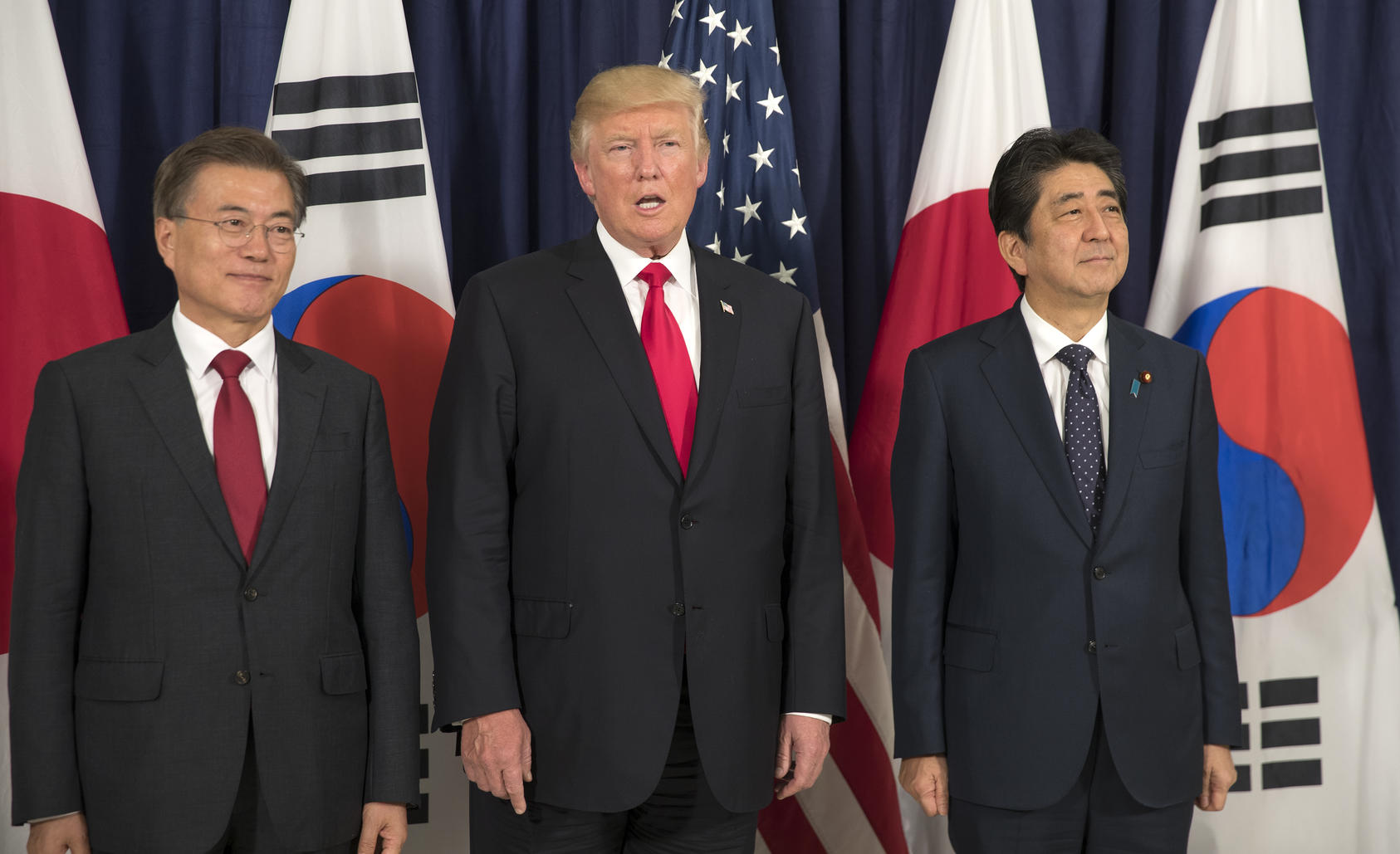President Donald Trump with President Moon Jae-in of South Korea, left, and Prime Minister Shinzo Abe of Japan, during the G20 summit in Hamburg, Germany, July 6, 2017. As the three allies prepared to meet on the sidelines of the United Nations General Assembly in September, Moon' softer stance towards North Korea has made him the odd man out. (Stephen Crowley/The New York Times)