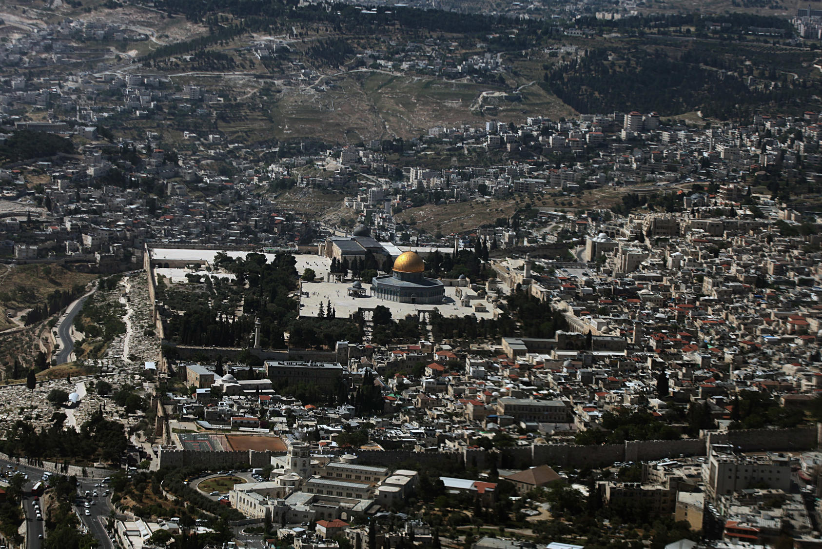 An aerial view of the Old City of Jerusalem, with the Al-Aqsa Mosque at the cente