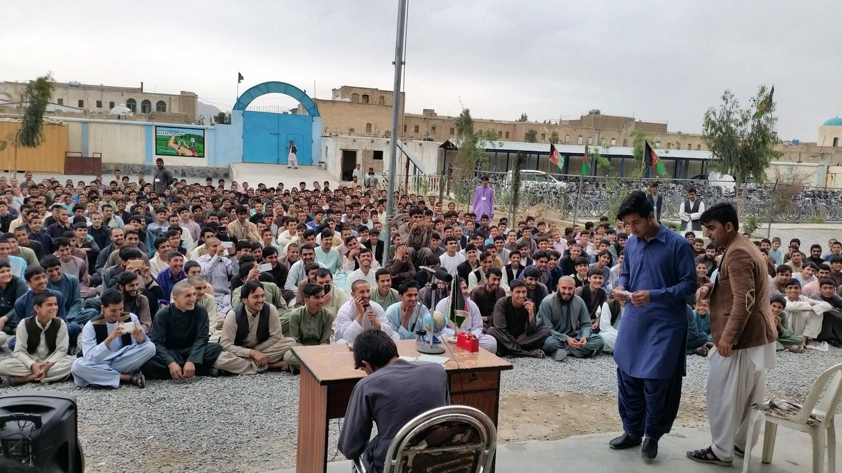 A crowd in Afghanistan's second-largest city, Kandahar, laughs during a performance by a local youth group that dramatized corruption by Afghan officials. (Photo: Bond Street Theater)