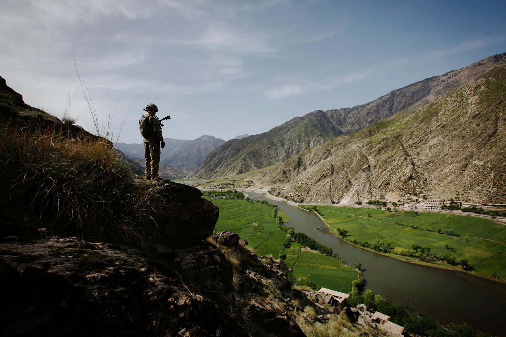 A soldier with U.S. Army's 4th Brigade looks over the Pech Valley in the Kunar province of Afghanistan, April 13, 2010. Photo Courtesy of The New York Times/Christoph Bangert