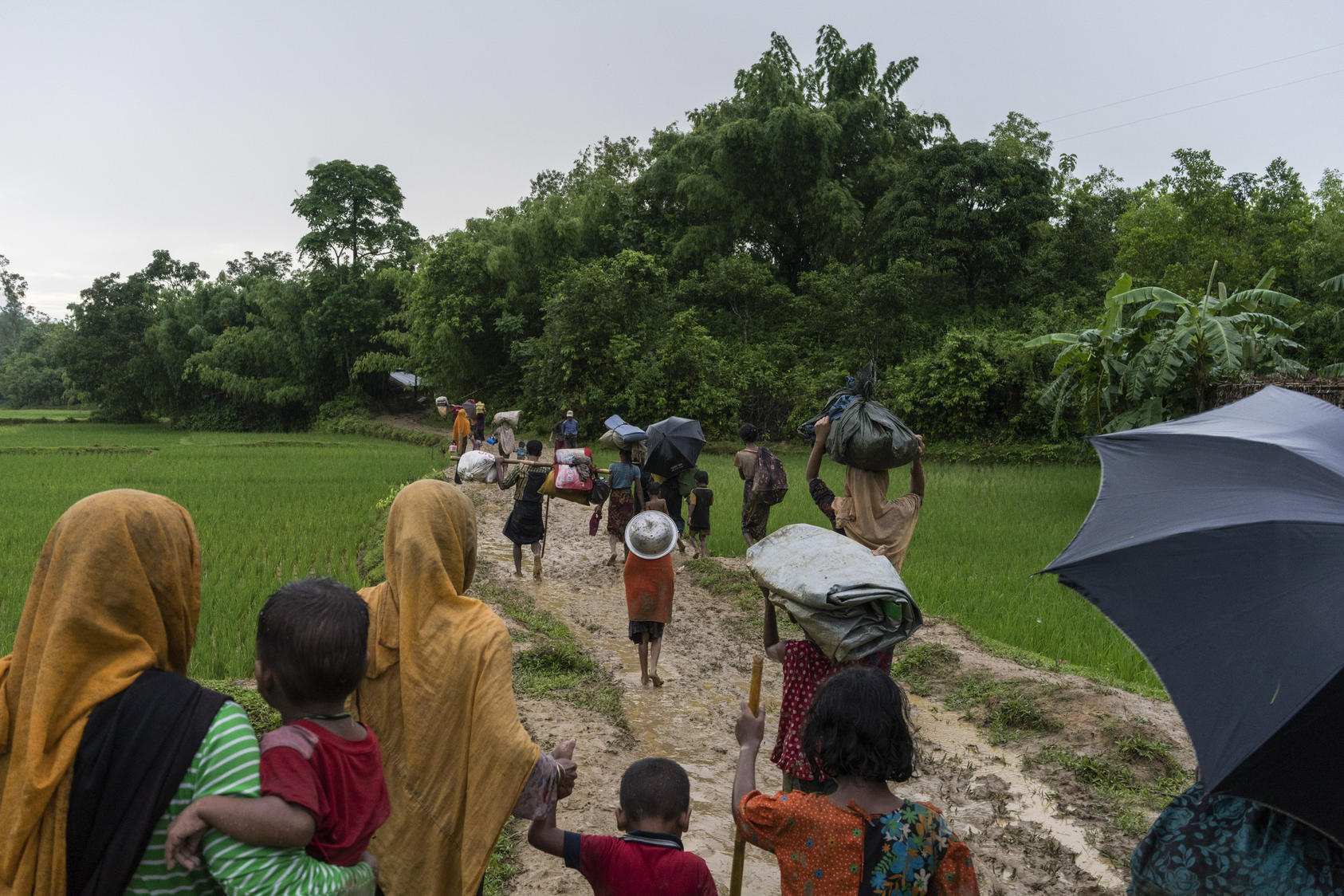 Rohingya refugees from Myanmar after crossing the border illegally near Amtoli, Bangladesh, Aug. 31, 2017. Bangladesh on Sept. 6 protested the huge influx of people fleeing violence in Myanmar and raised concerns with the Myanmar government about reports that its military was placing land mines along the countries' shared border. Photo Courtesy of The New York Times/ Adam Dean