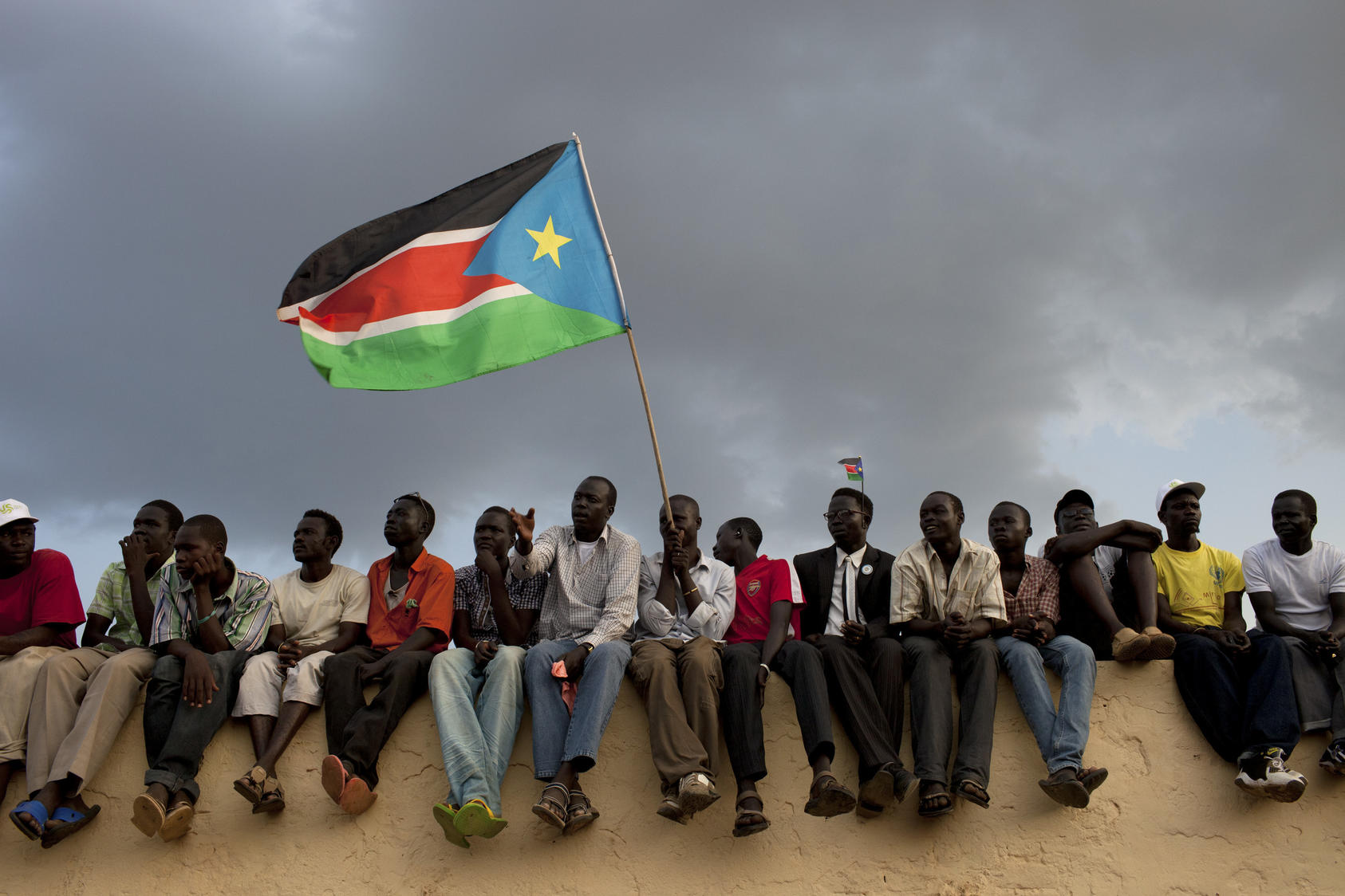 Fans wave the South Sudan flag