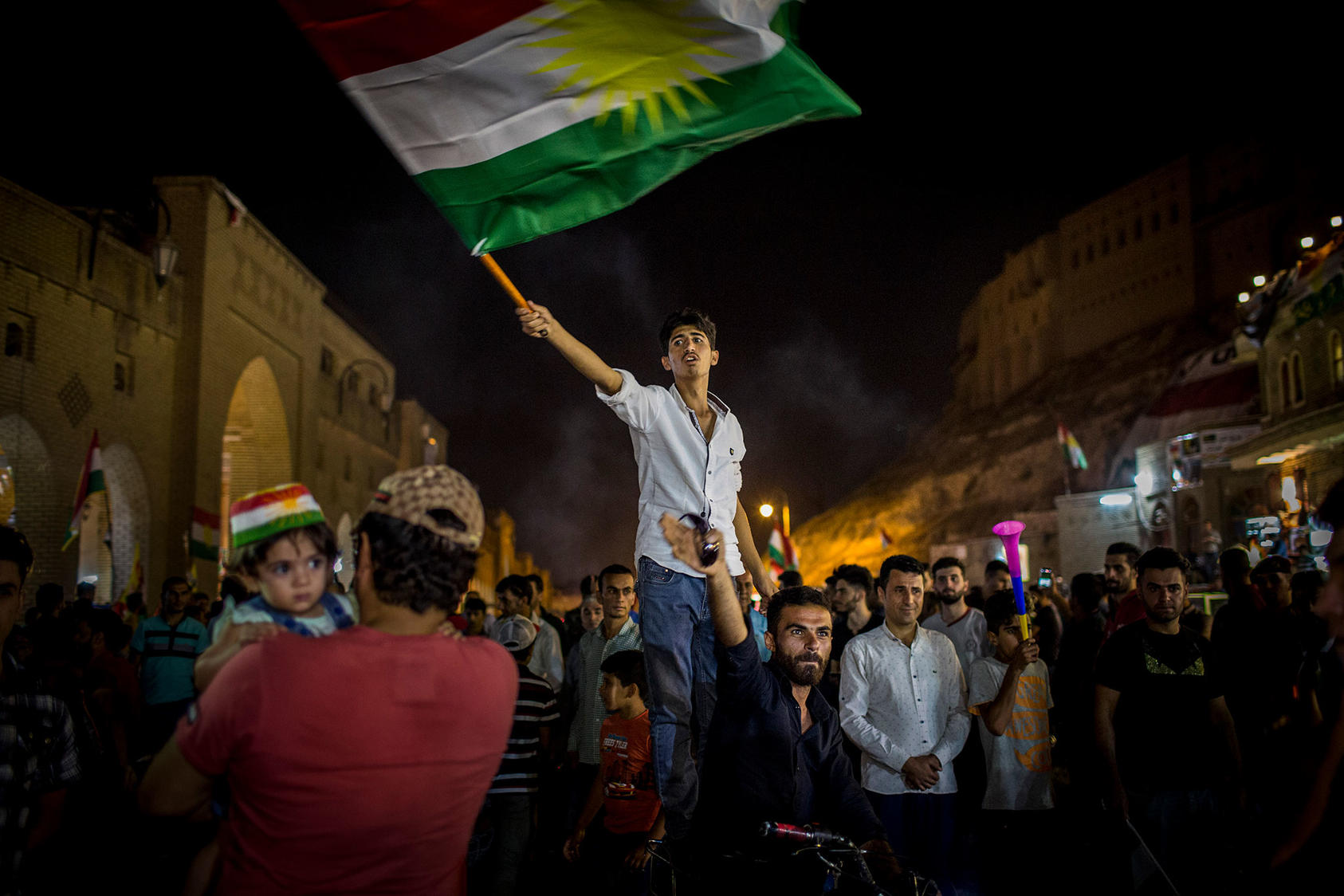 A man waves the Kurdish flag after the results of an independence referendum were announced in Irbil, Iraq, Sept. 27, 2017