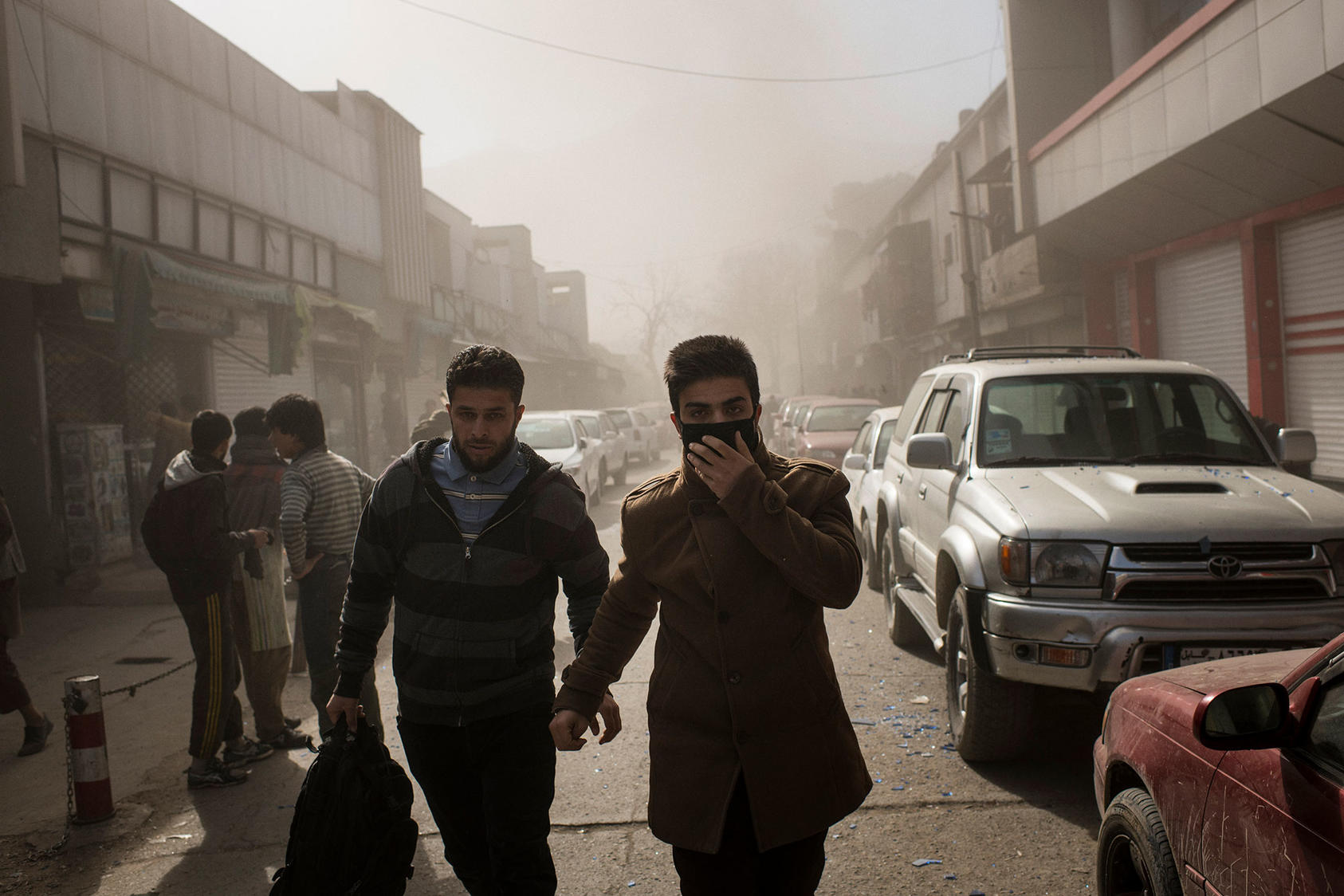 Smoke hangs in the air near the site of a bombing in Kabul, Afghanistan that killed at least 95 people, Jan. 27, 2018