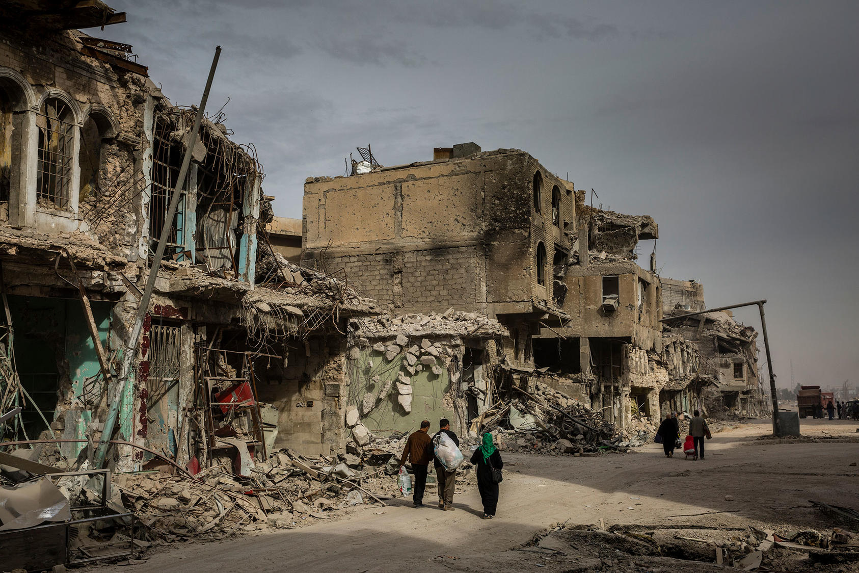 Iraqis return to their destroyed homes in the Old City of Mosul, in December 2017.