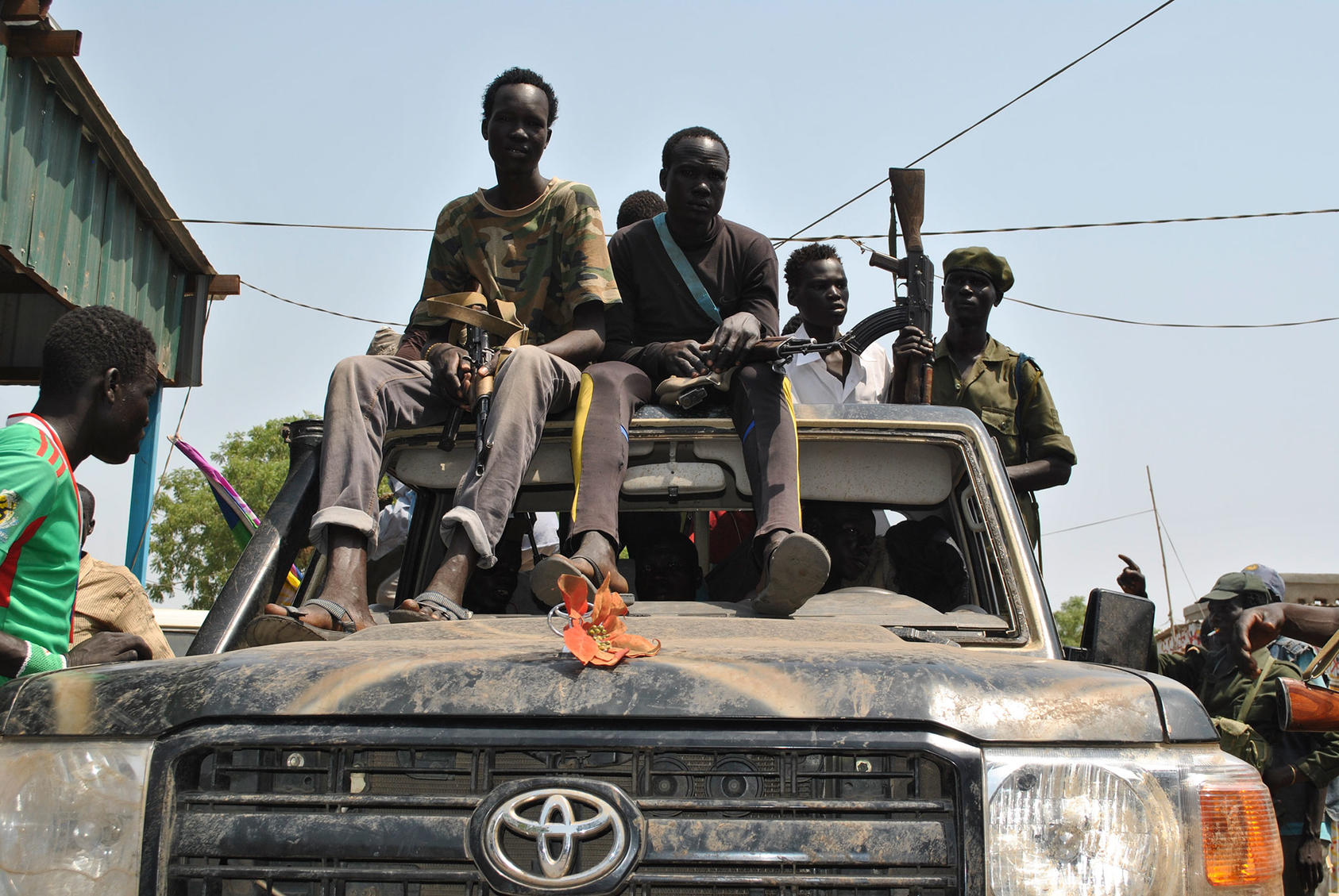 Civilian militantssit atop a truck in Nasir, South Sudan