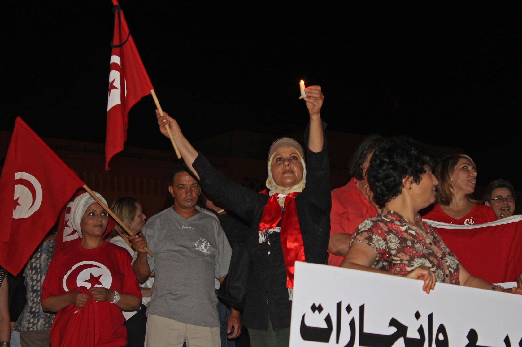 Activists organize a candlelight protest in Tunis