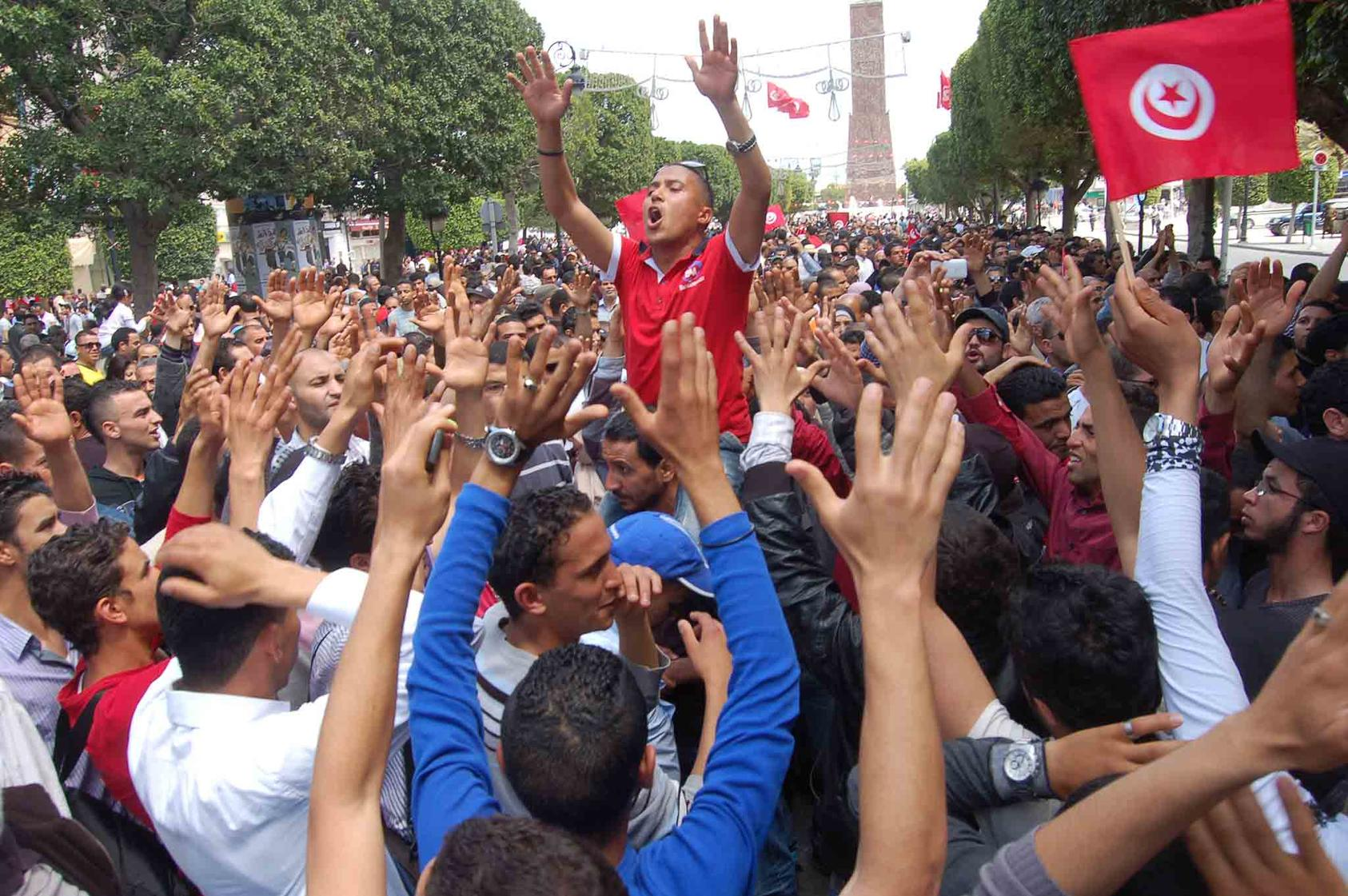 Tunisians demonstrated in Tunis in 2012. The country's nonviolent, pro-democracy movement, fueled largely by youth, competes against the appeal of extremist groups. (Wikimedia/CC License 2.0)