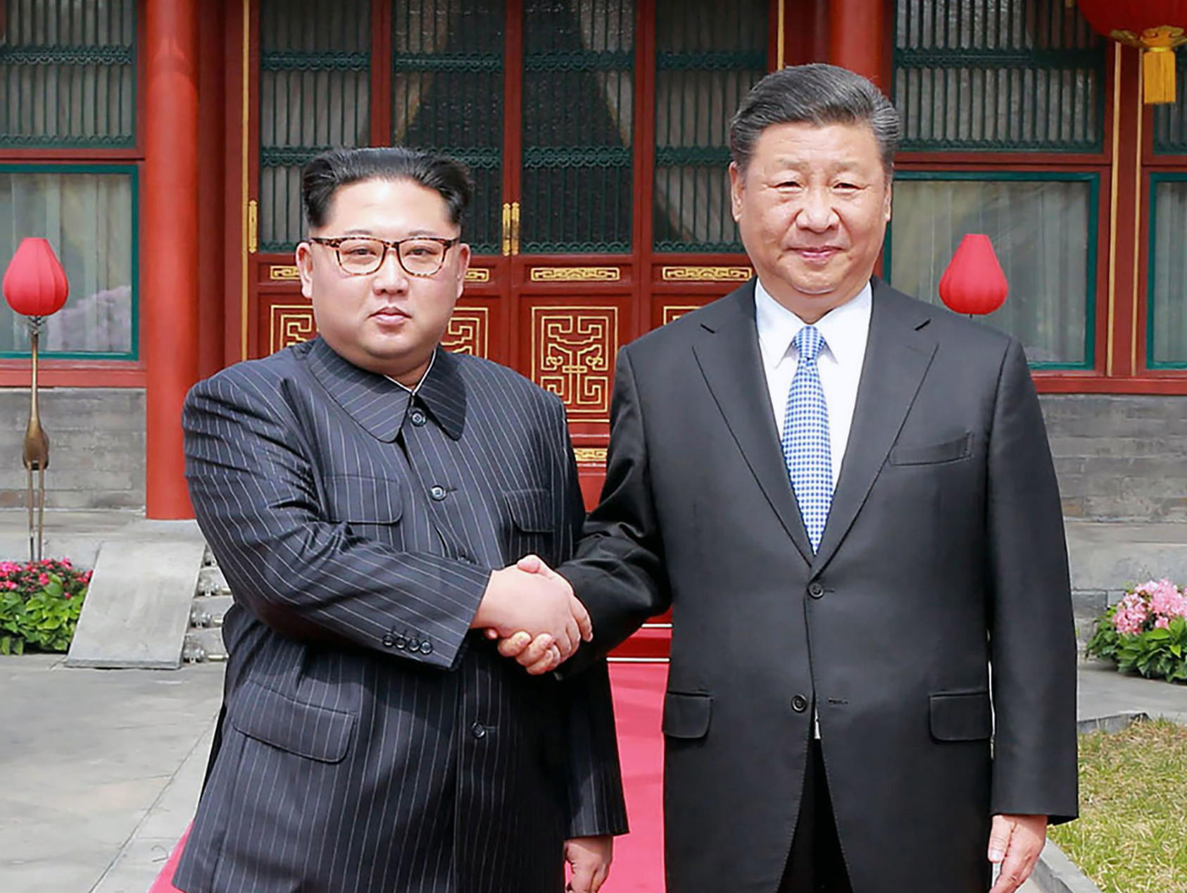 President Xi Jinping of China, right, shakes hands with Kim Jong-un, North Korea's leader