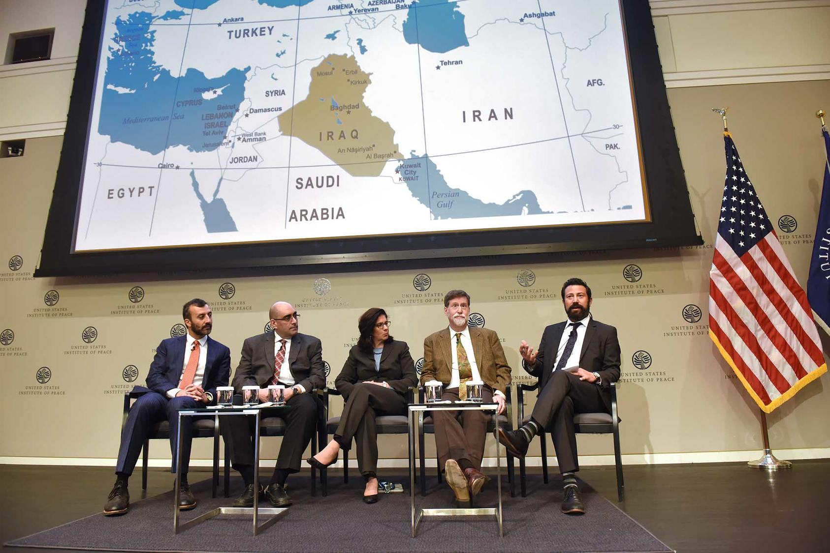 Panelists from the second discussion of the day discussed the region surrounding Iraq and Syria with a map displayed overhead