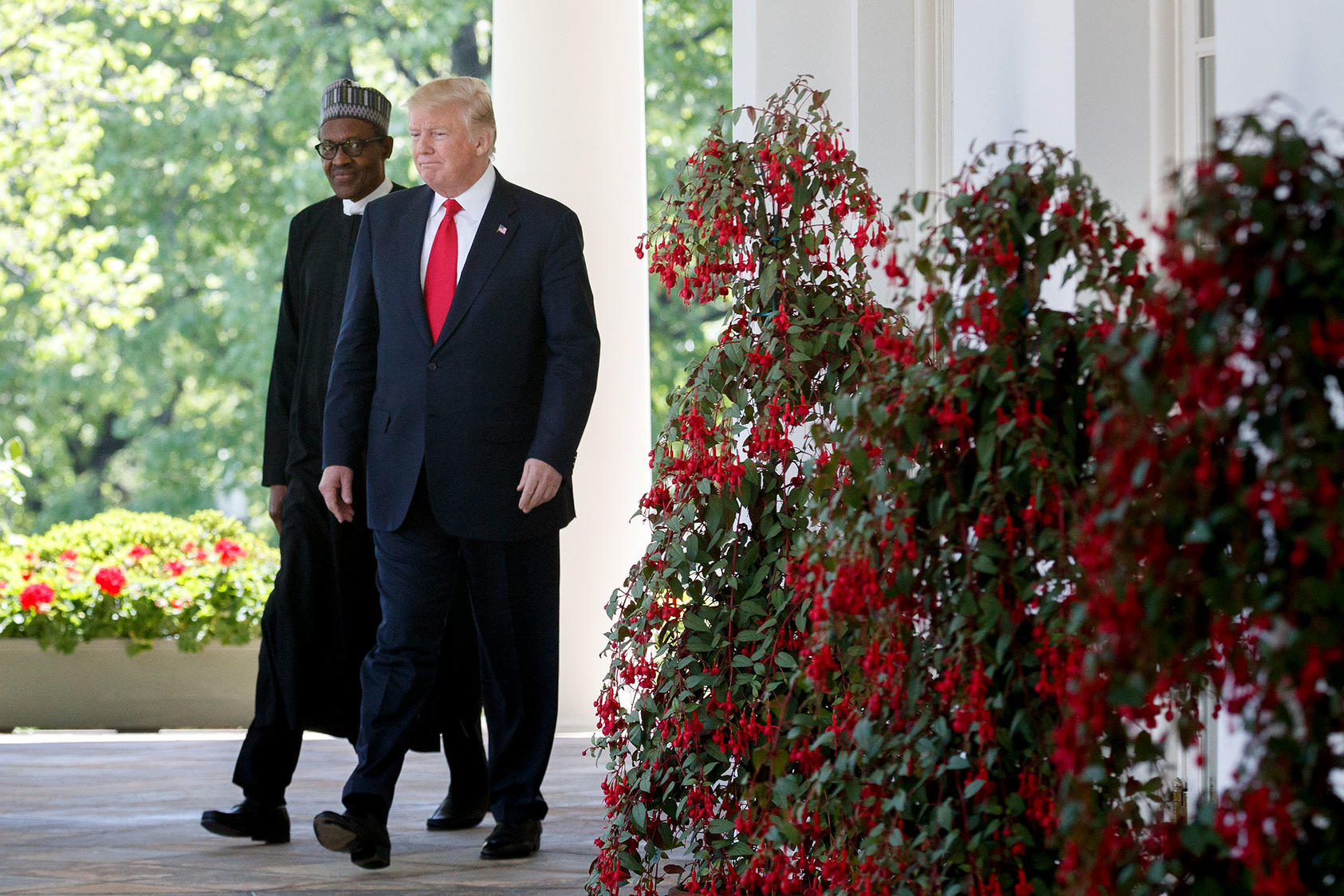 President Donald Trump and Nigerian President Muhammadu Buhari in the Rose Garden at the White House, where they held a joint news conference, in Washington, April 30, 2018. (Tom Brenner/The New York Times)