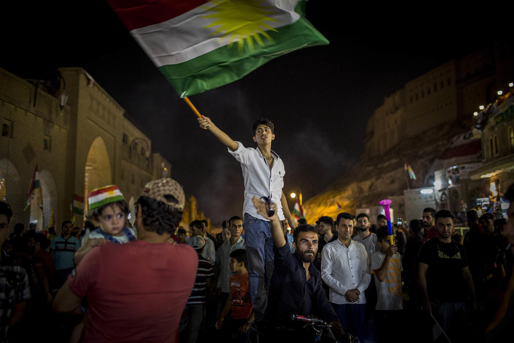 A man waves the Kurdish flag after the results of an independence referendum were announced in Irbil, Iraq. (Ivor Prickett/The New York Times)