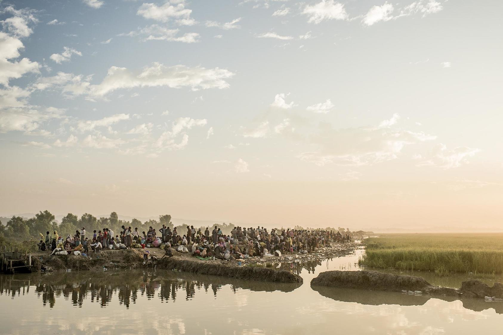 Rohingya refugees after crossing from Burma into Bangladesh near Anjuman Para. (Tomas Munita/The New York Times)