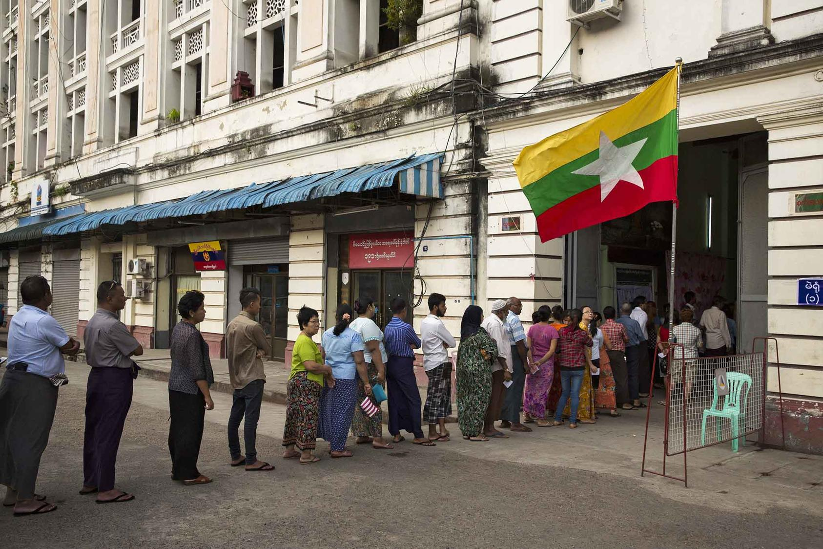 Citizens line up outside a polling station in Yangon to vote in the historic 2015 elections. (Adam Dean/The New York Times)