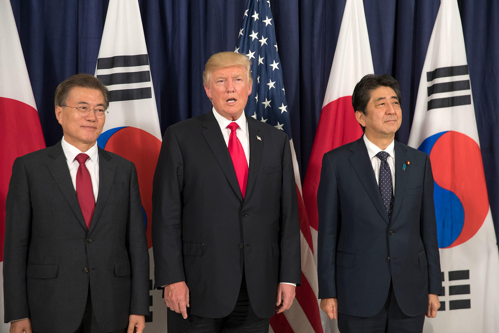 South Korean President Moon Jae-in, President Donald Trump and Japanese Prime Minister Shinzo Abe before the start of the Northeast Asia Security dinner. (Stephen Crowley/The New York Times)