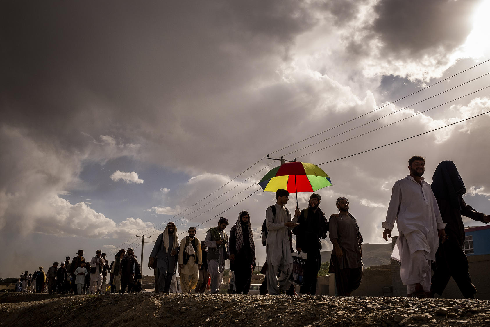 Members of the peace march walk to the edge of Ghazni, Afghanistan on June 11, 2018. (Jim Huylebroek/The New York Times)