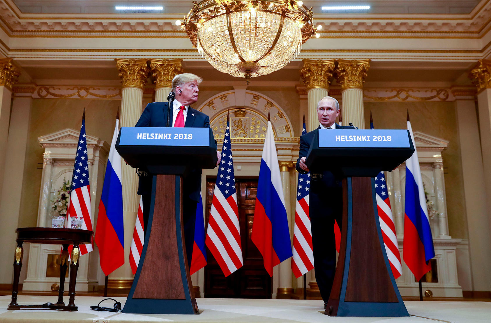 President Donald Trump and President Vladimir Putin of Russia appear at a joint news conference in Helsinki, Finland