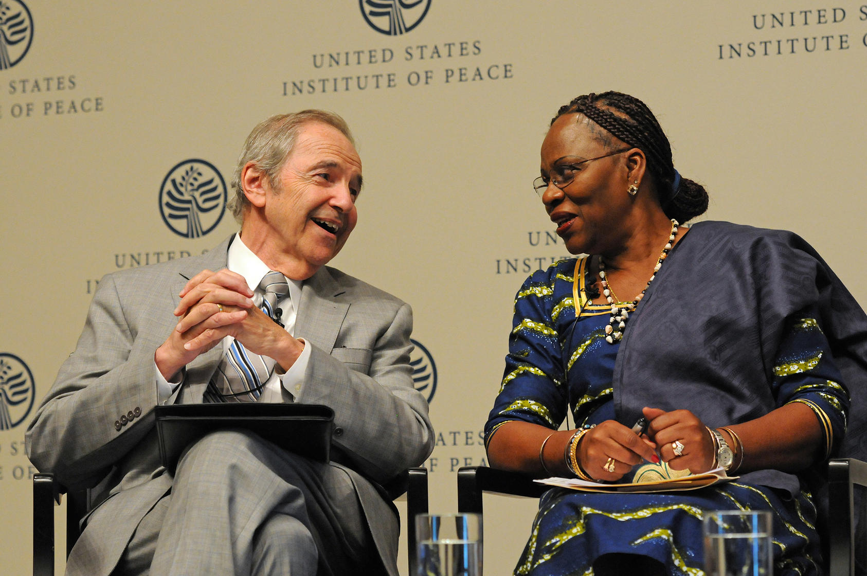 Ambassador Lyman and former Mozambique Ambassador to the U.S. H.E. Amélia Matos Sumbana at a USIP event on the role of women's leadership in peacemaking and development in Africa, May 26, 2015.