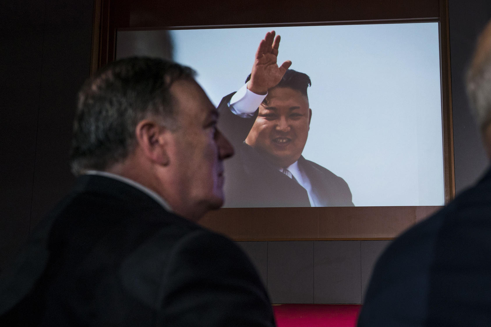 Secretary Pompeo looks on as a video displays Kim Jong Un before President Donald Trump's news conference on Sentosa Island in Singapore, June 12, 2018. (Doug Mills/The New York Times)