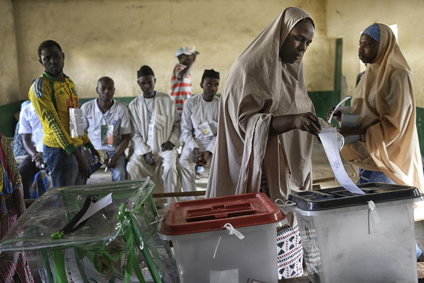 A woman votes at a polling station in Kano, Nigeria, March 28, 2015. (Samuel Aranda/The New York Times)