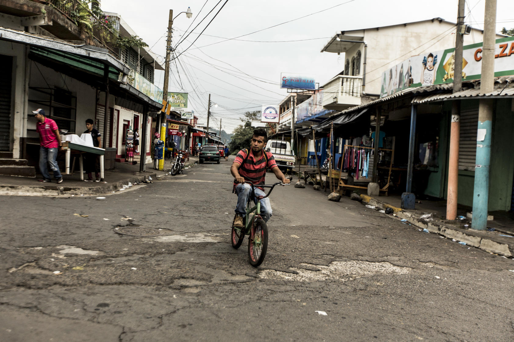 A bicyclist in Berlín, a town in El Salvador where gangs are somewhat less of a problem than in the larger cities