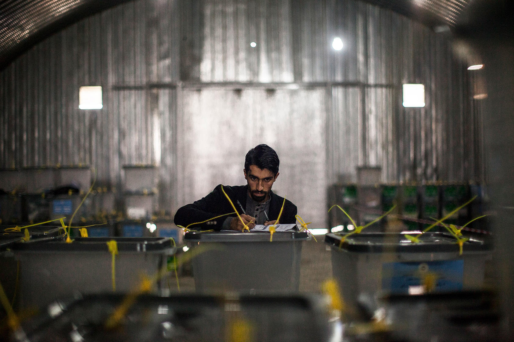 A man working for the Afghan Independent Election Commission inventories ballot boxes at IEC headquarters in Kabul