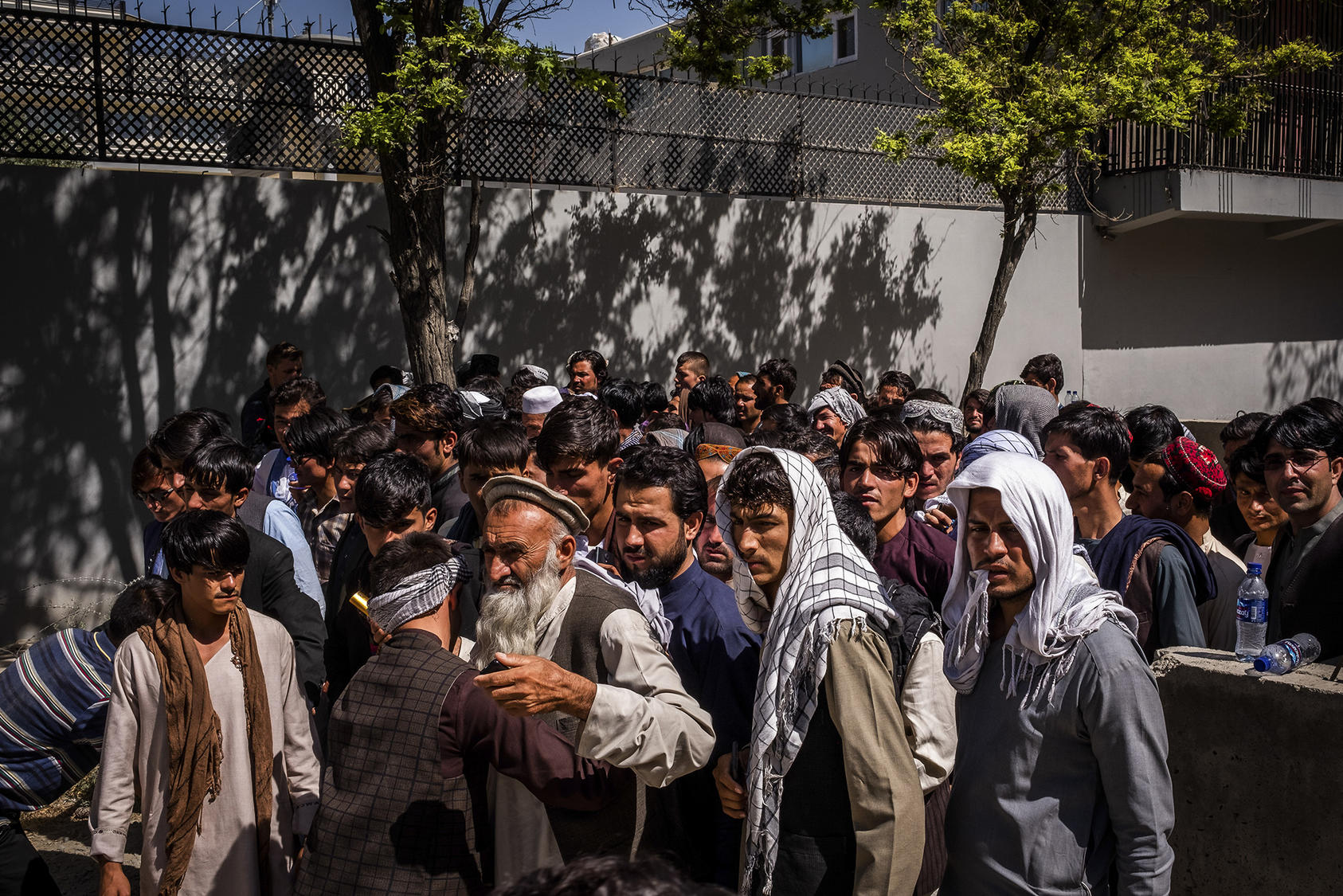 Attendees are searched before entering a political rally in Kabul. Voting under threat of Taliban violence, Afghans across the country cast ballots for parliament on October 20. (Jim Huylebroek/The New York Times)
