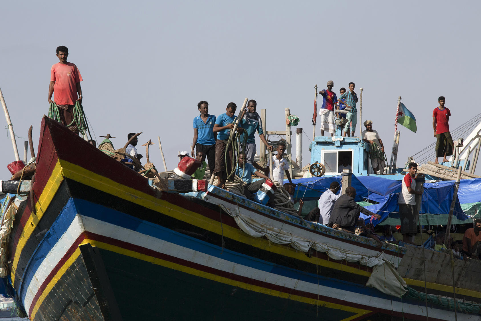 Refugees fleeing the war in Yemen arrive at the port in Djibouti after crossing a narrow strait in the Red Sea, April 20, 2015. (Tyler Hicks/The New York Times)