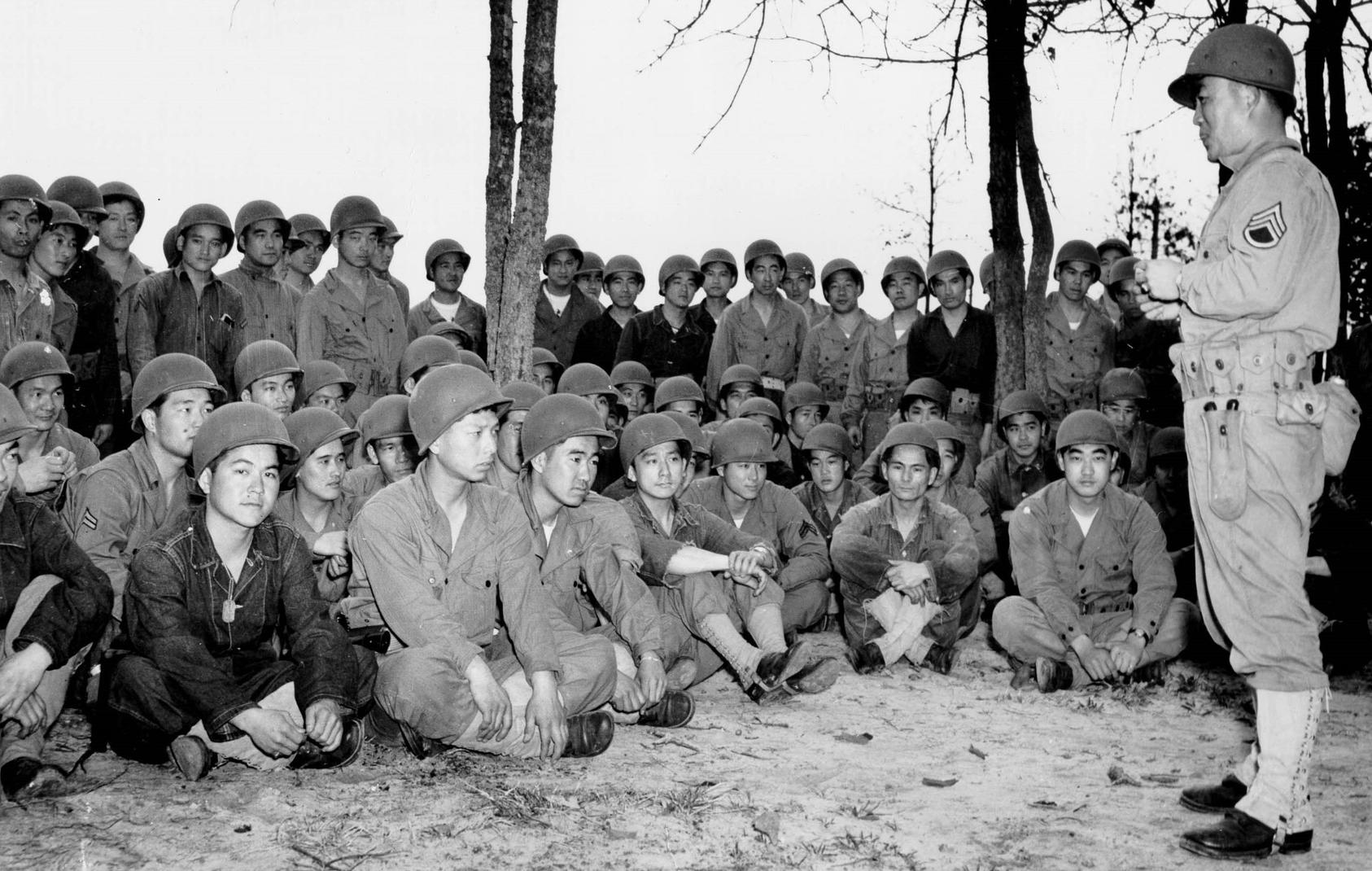 Japanese-American troops of the Army's 100th Infantry Battalion gather during training in 1943. Lieutenant Spark Matsunaga helped lead the battalion into World War II combat in Italy. (U.S. Army)