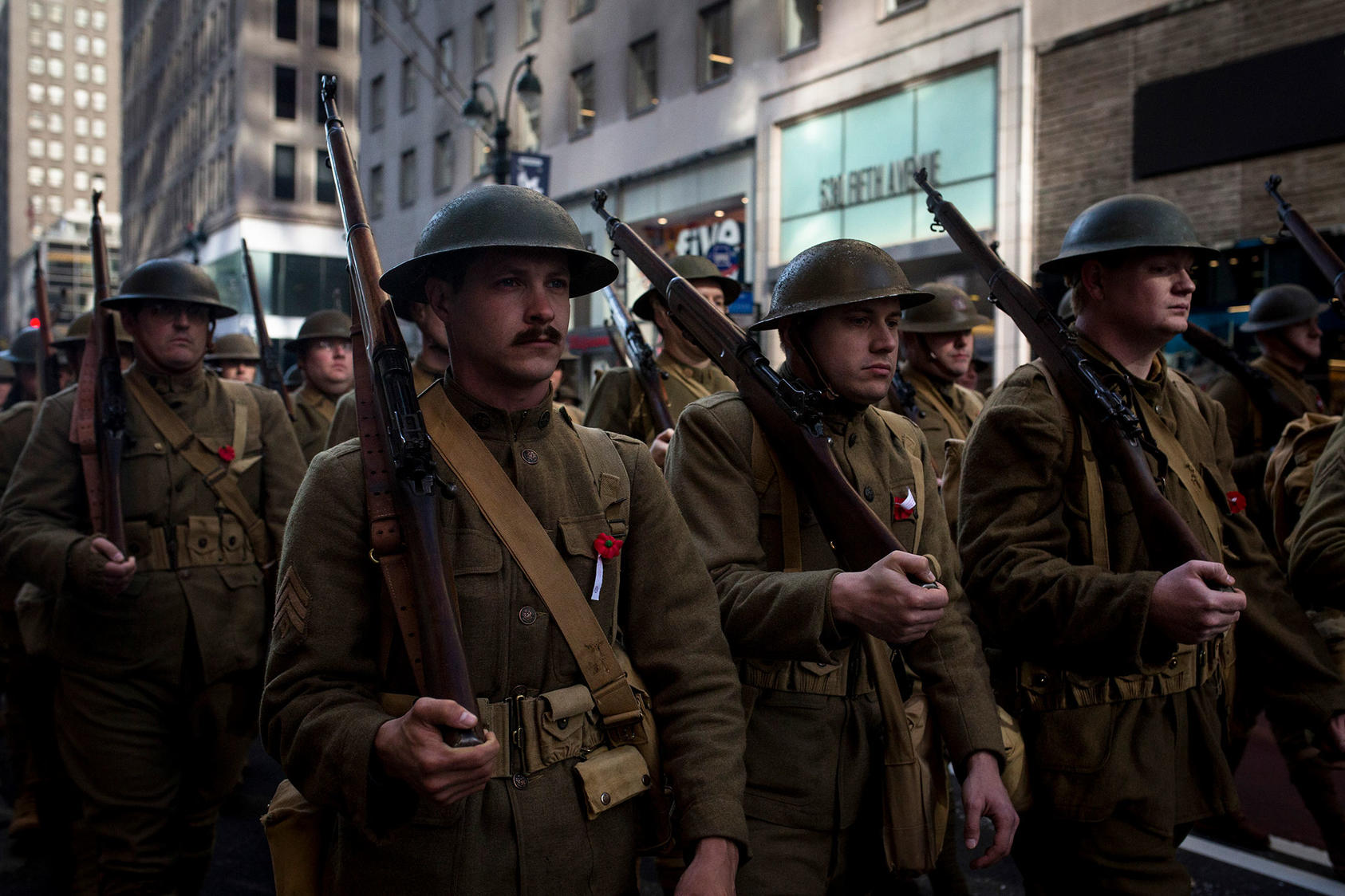 Re-enactors wear World War I era U.S. Army uniforms during the Veterans Day Parade in New York, Nov. 11, 2018. This year marks the 100th since the end of the war. (Dave Sanders/The New York Times)