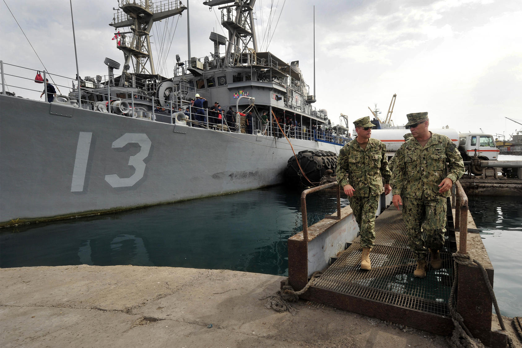 Rear Adm. John Scorby, then commander of Navy Region Europe, Africa, Southwest Asia, left, speaks with Cmdr. Jeffrey Marty, right, during a brief of port operations in the port of Djibouti on May 19, 2015. (Photo: U.S. Navy)