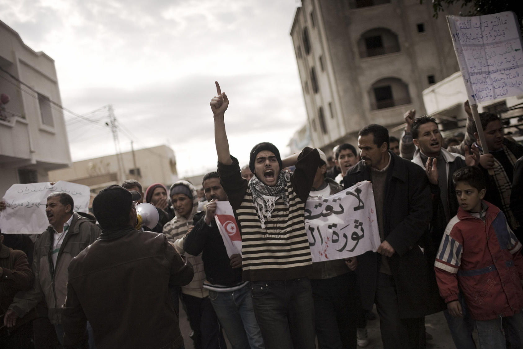Protesters chant slogans against the political party of ousted President Zine el-Abedine Ben Ali in Sidi Bouzid, Tunisia, on Jan. 21, 2011. (Moises Saman/The New York Times)