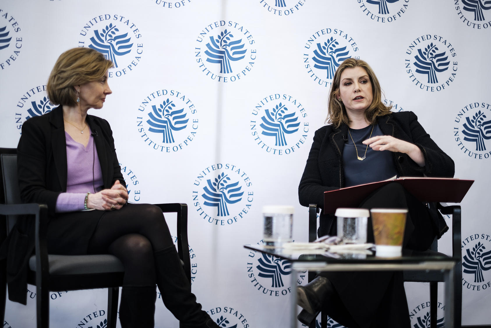 Penny Mordaunt (right), U.K. secretary of state for international development and minister for women and equalities, talks with Nancy Lindborg (left), president of the U.S. Institute of Peace.