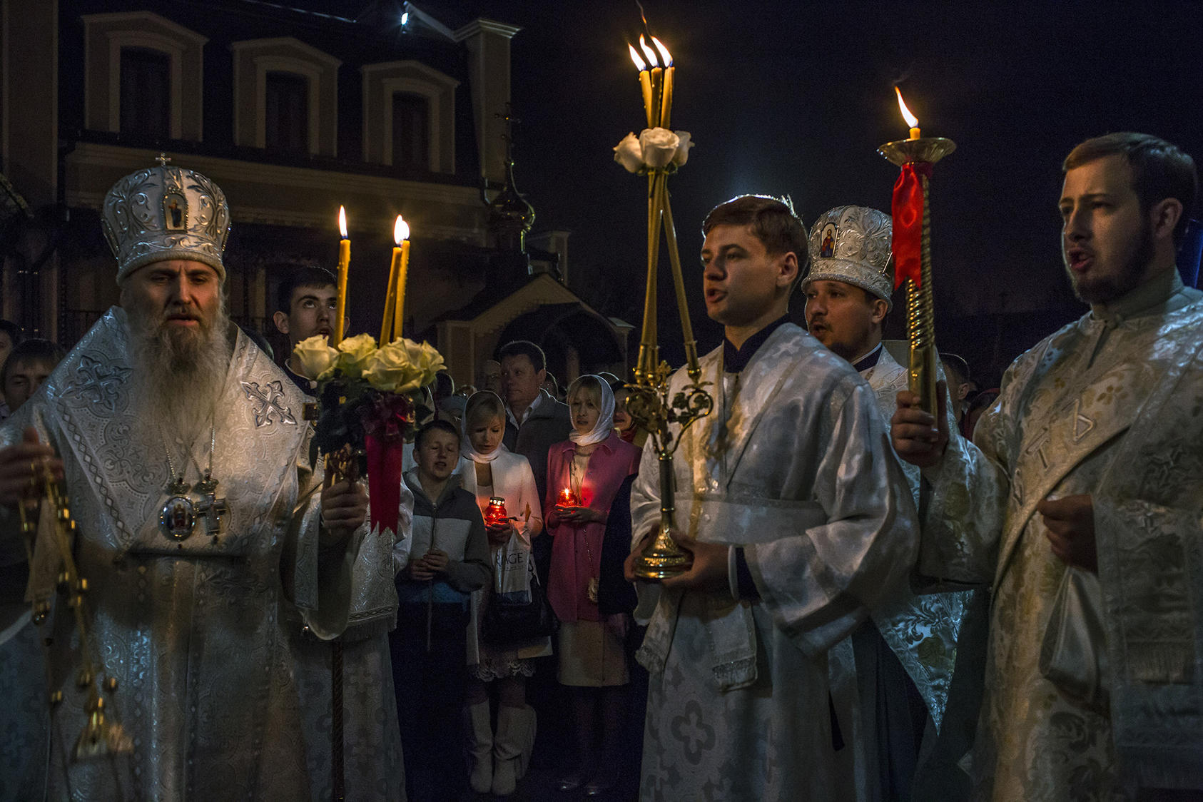 Orthodox worshippers during a midnight Easter ceremony outside the St. Nicholas Cathedral in Donetsk, Ukraine, April 20, 2014. (Mauricio Lima/The New York Times)