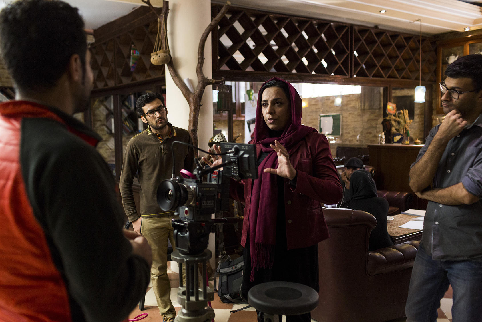 Roya Sadat, center, at a test shoot for a TV drama she directed in Kabul, Oct. 18, 2017. Sadat sold her apartment, car and jewelry to make a movie on women's rights. It's Afghanistan's selection for the Oscars now. (Jim Huylebroek/The New York Times)
