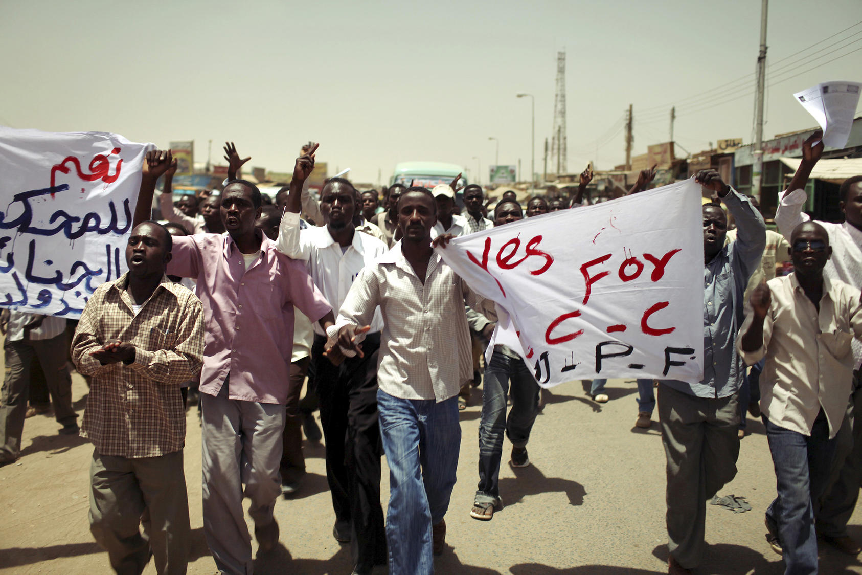 Darfurian men protest against dictator Omar al-Bashir in the streets of Khartoum, Sudan, April 11, 2010. (Jehad Nga/The New York Times).