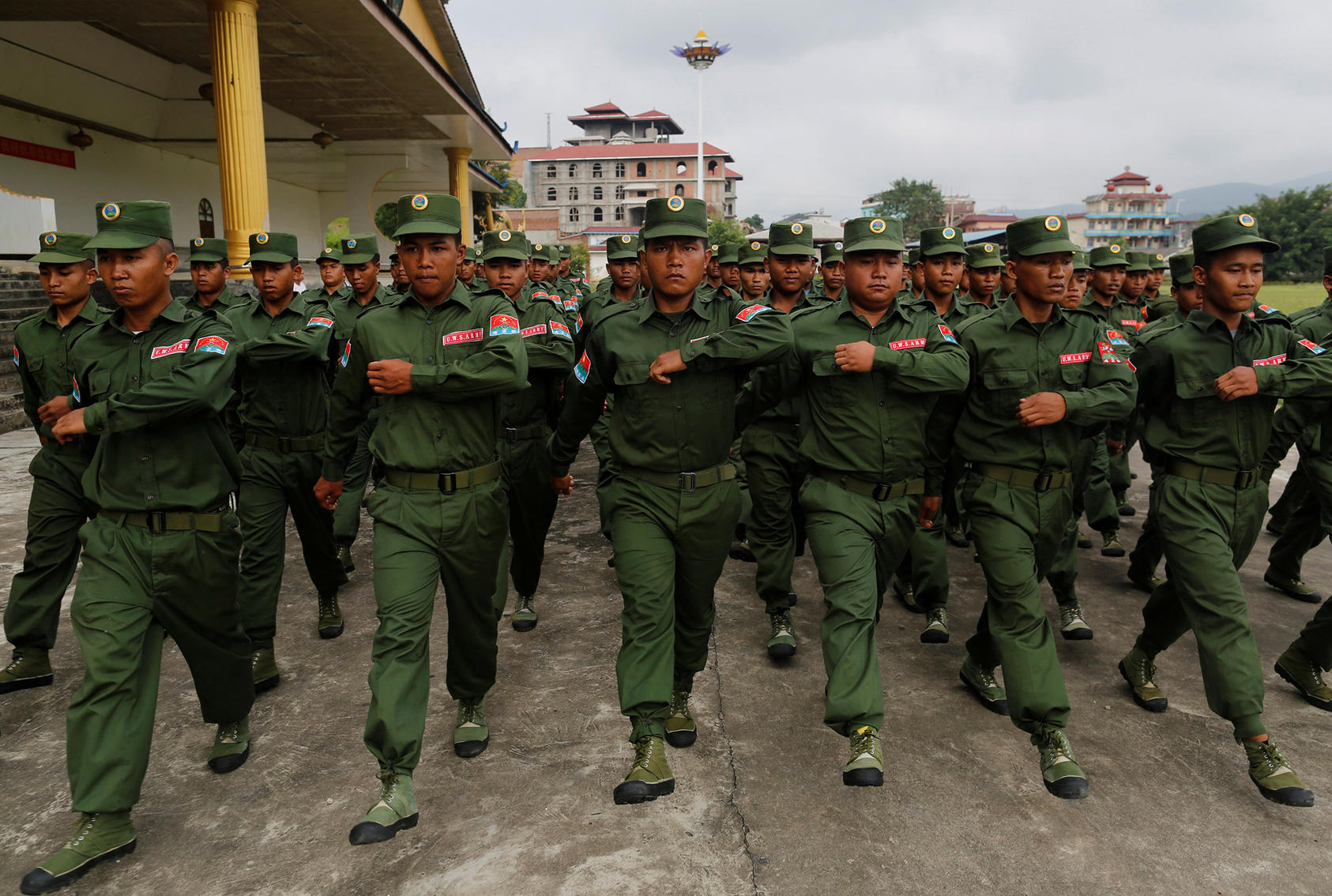 United Wa State Army soldiers march during a media display in Panghsang, in the Wa Self-Administered Division of Shan State, Burma. (Photo by Soe Zeya Tun/Reuters)
