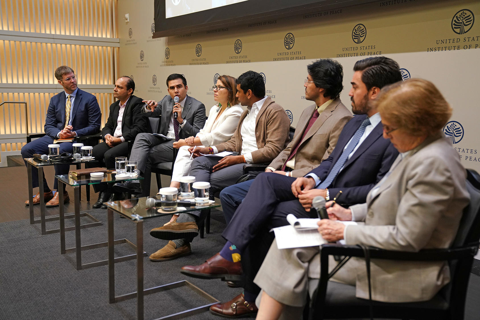 Left to right: USIP's Steve Hege; Colombian lawmakers John Jairo Hoyos, Carlos Ardila, Juanita Goebertus, David Racero, David Pulido, and Gabriel Santos; Woodrow Wilson Center's Cynthia Arnson.