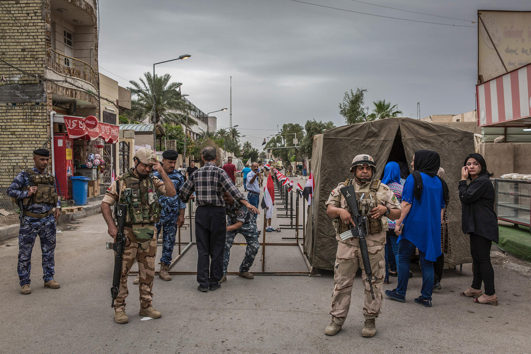 Soldiers stand guard at a polling place during Iraq's national elections, in Baghdad, May 12, 2018. (Ivor Prickett/The New York Times)