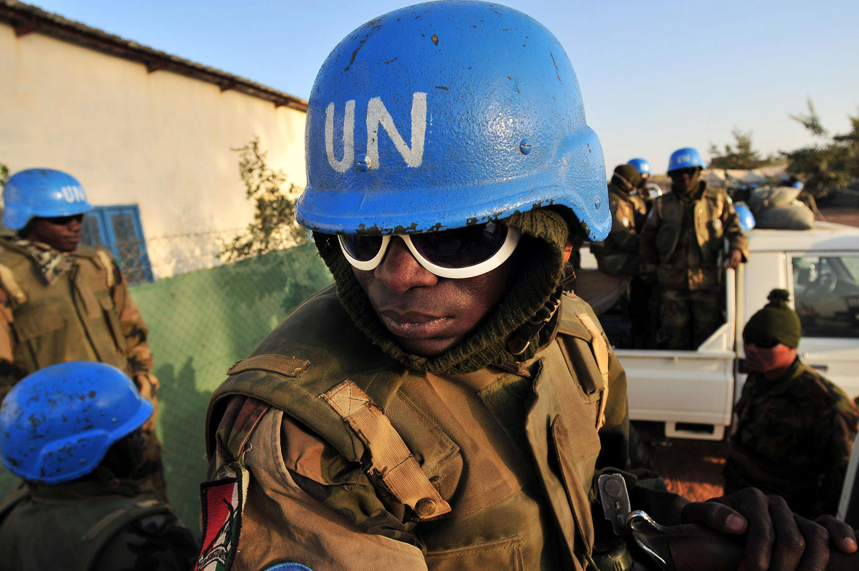 Nigerian soldiers with the United Nations peacekeeping force in Darfur prepare to head out on patrol from their base in El Geneina, Sudan, on Feb. 26, 2008. (Lynsey Addario/The New York Times)