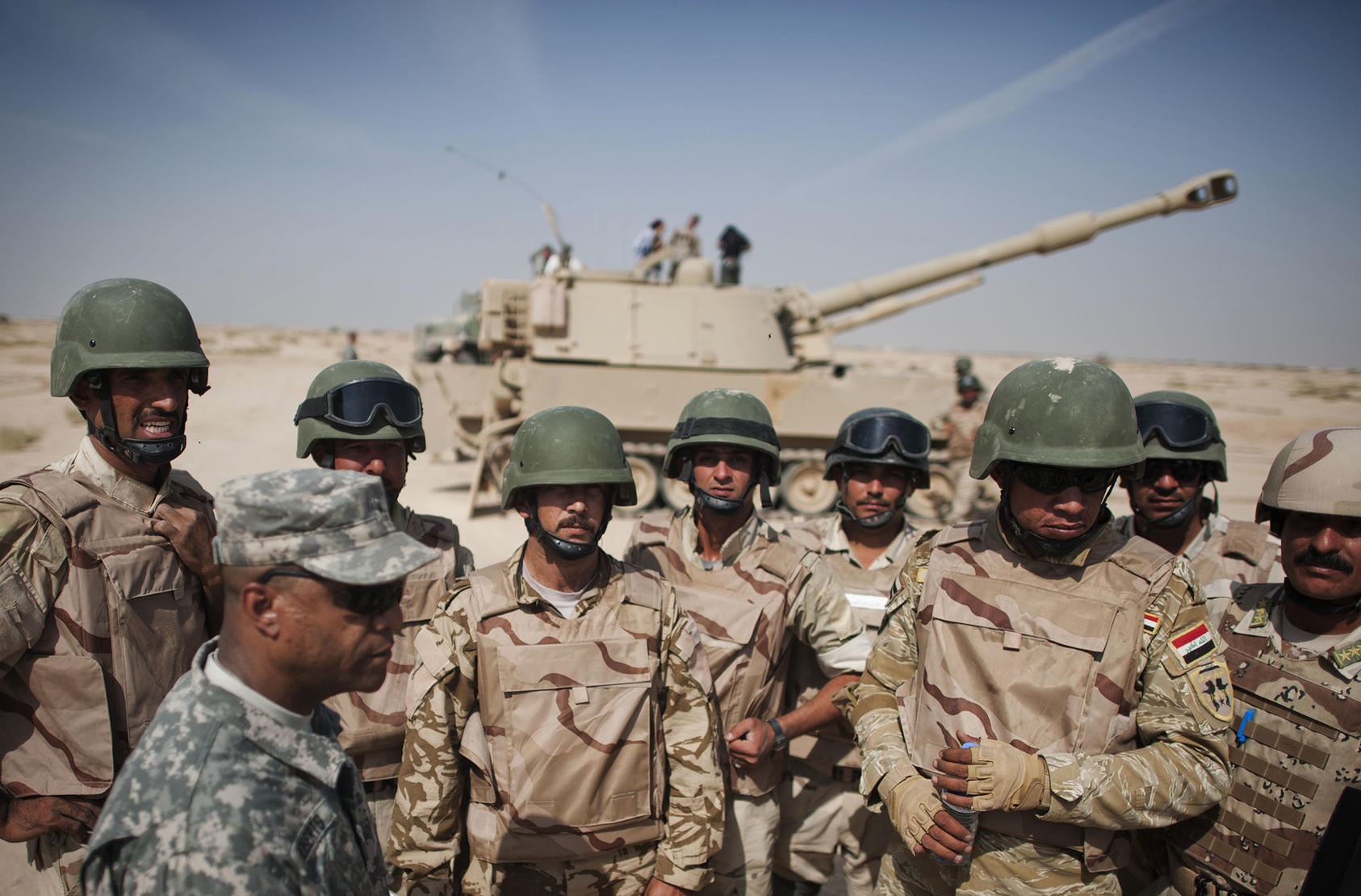 The U.S. military organizes a demonstration at the Iraqi Armor School after the Iraqi soldiers completed a 21-day tank training course, in Besmaya, Iraq, Oct. 18, 2011. (Andrea Bruce/The New York Times)
