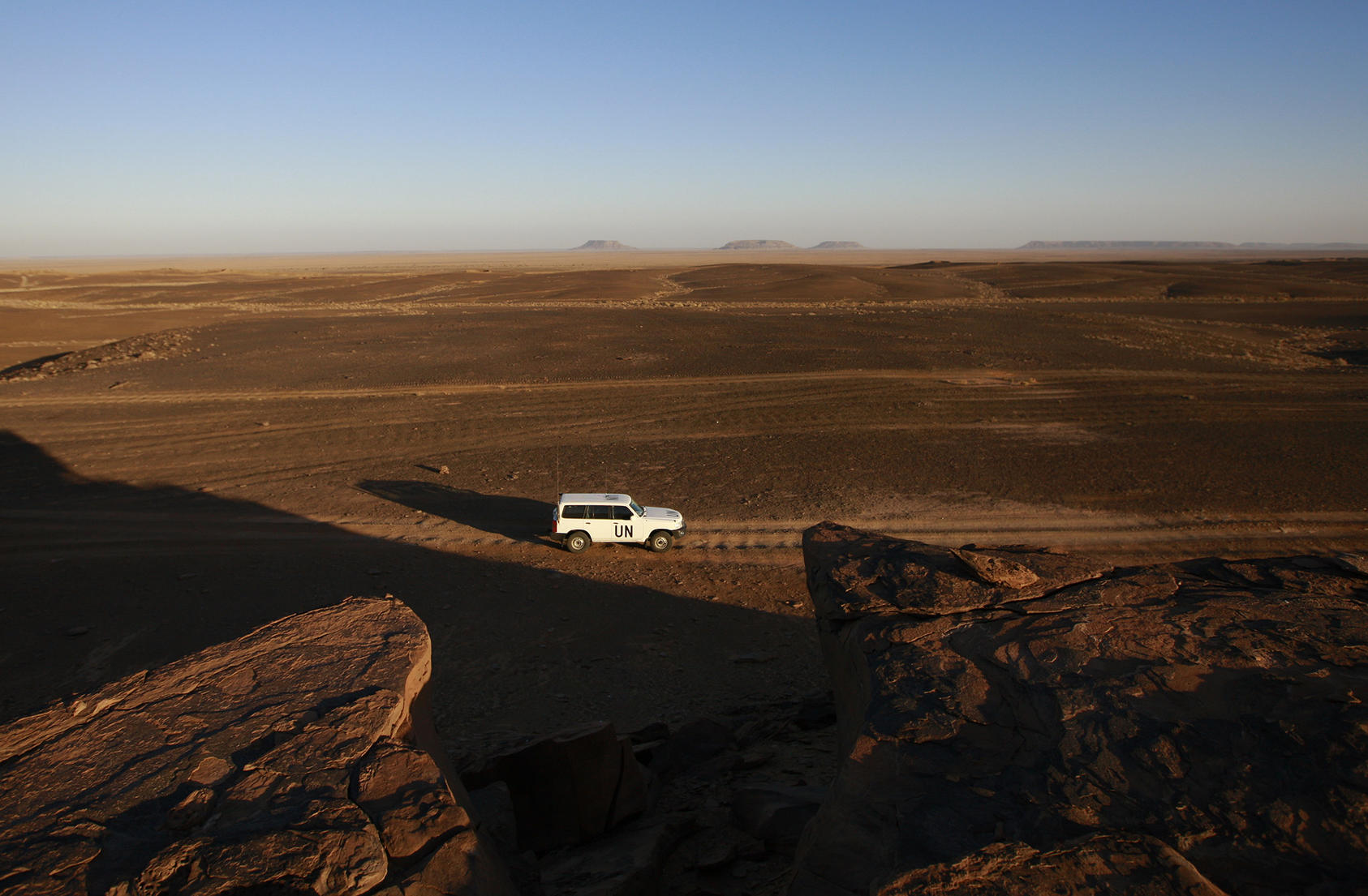 U.N. ceasefire monitors patrol the Smara region of the Western Sahara. U.S. pressure for negotiations aims to end the four-decade conflict, including the costs of U.N. involvement. (U.N. photo/Martine Perret)