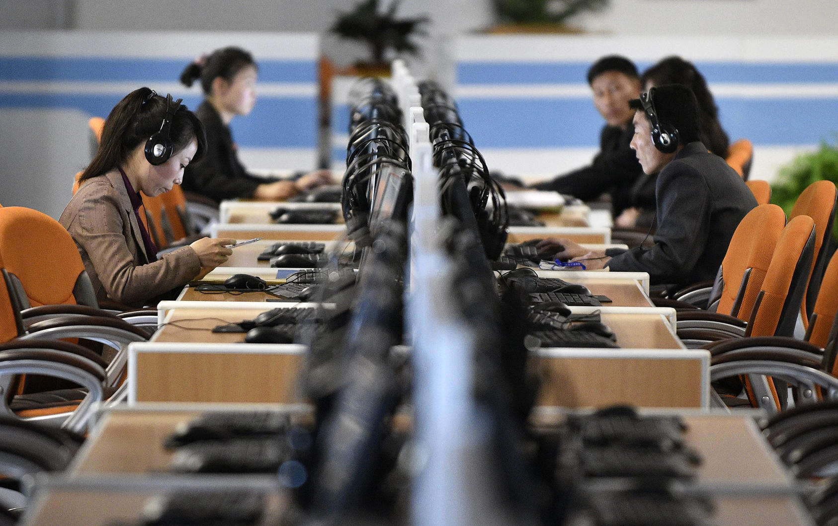 Visitors use computers at the Sci-Tech Complex, a repository for digital information located on Ssuk Island in Pyongyang. (Photo by Franck Robichon/ EPA/ Shutterstock)