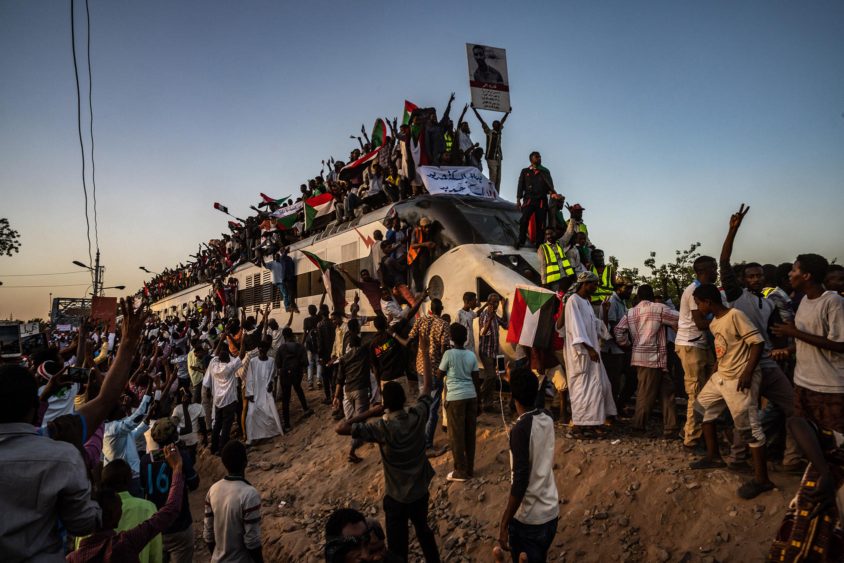 A train carrying demonstrators from al-Atbara arrives in Khartoum, Sudan, April 23, 2019. (Bryan Denton/The New York Times)