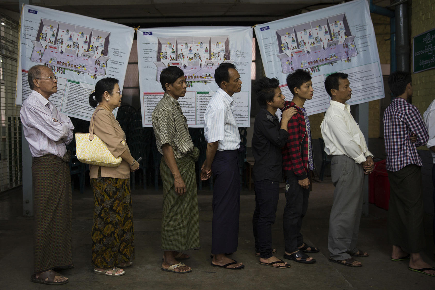 Voters line up at a polling station in Dagon High School in the Dagon township of Yangon, Myanmar, Nov. 8, 2015. (Adam Dean/The New York Times)